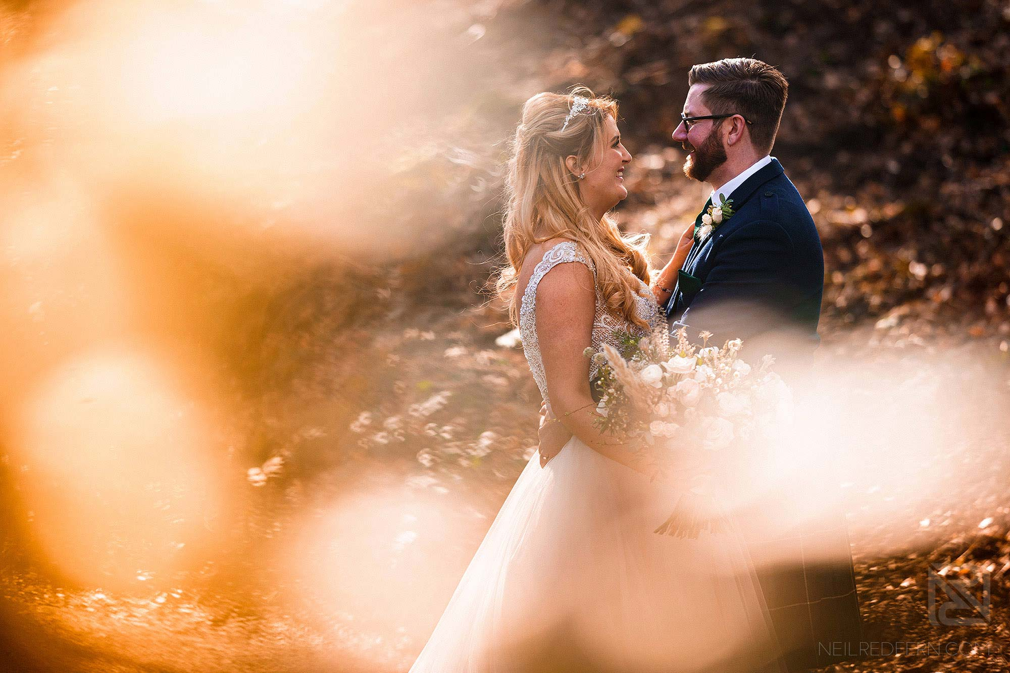creative photograph of newlyweds outside Peckforton Castle