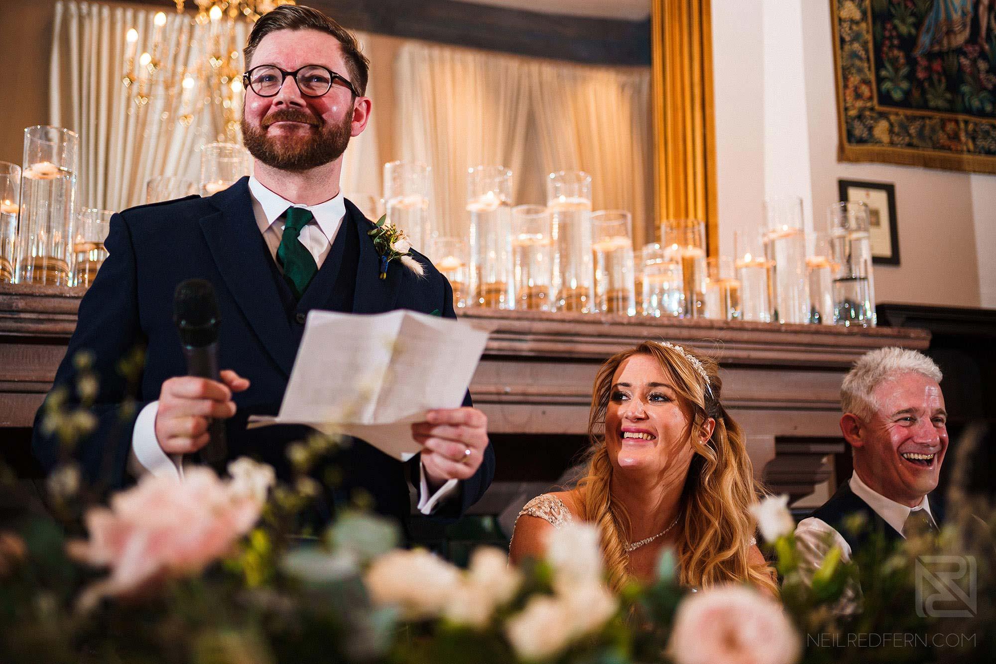 groom giving speech at Peckforton Castle