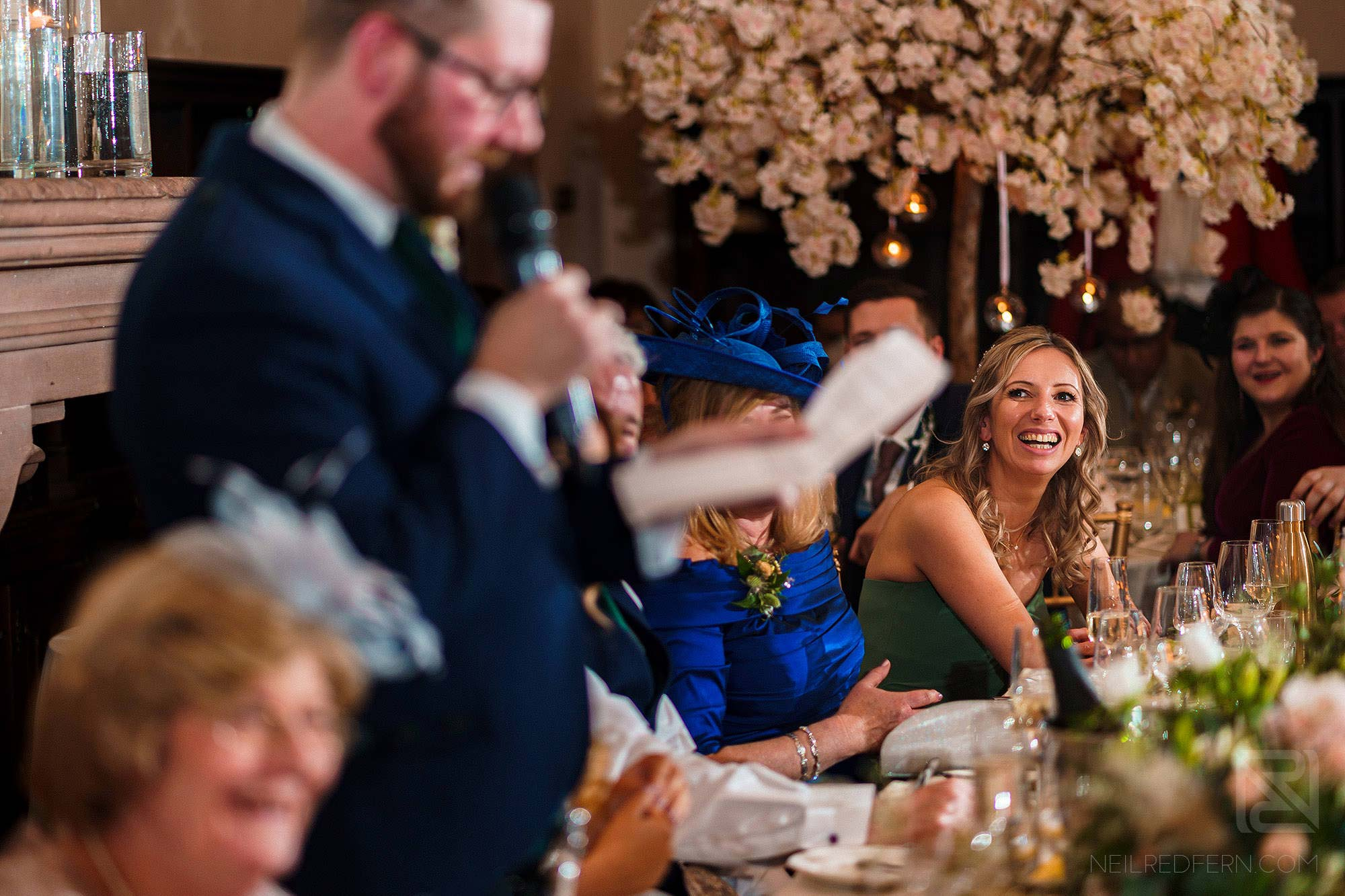 bridesmaids laughing during groom's speech