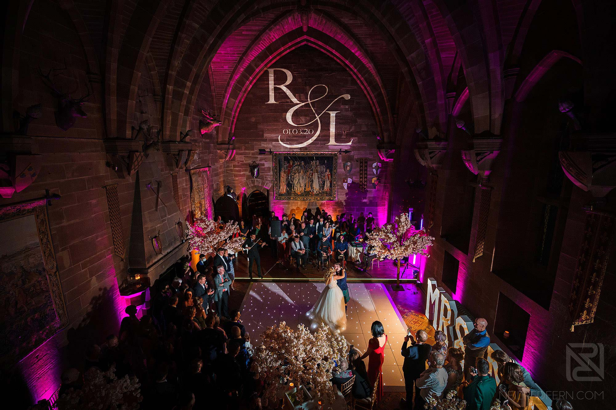 wide angle shot of first dance at Peckforton Castle