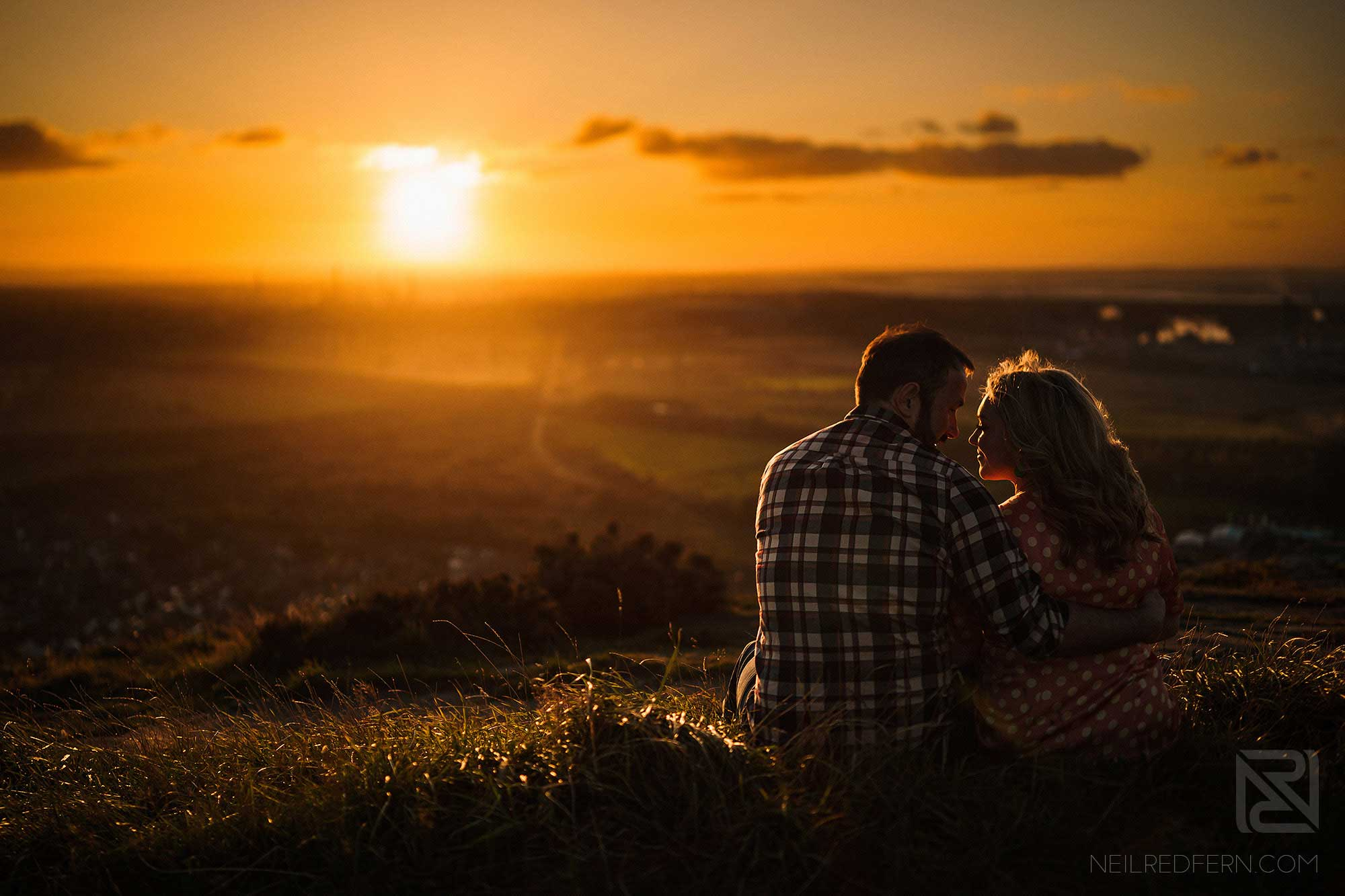 romantic photograph of couple relaxing at sunset in cheshire