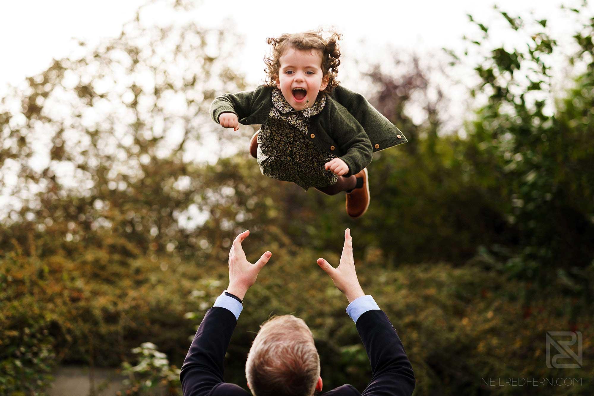 little girl laughing on family portrait shoot