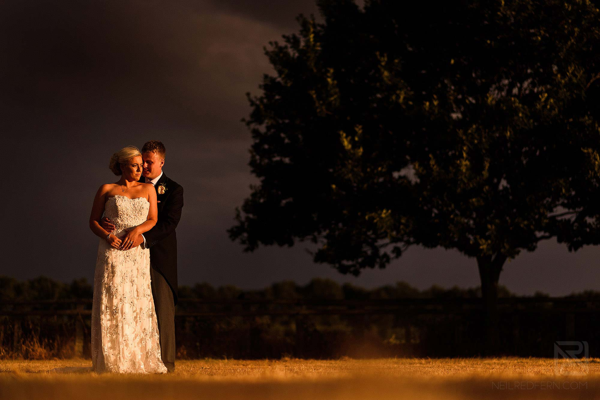 bride and groom portrait wit moody dark sky