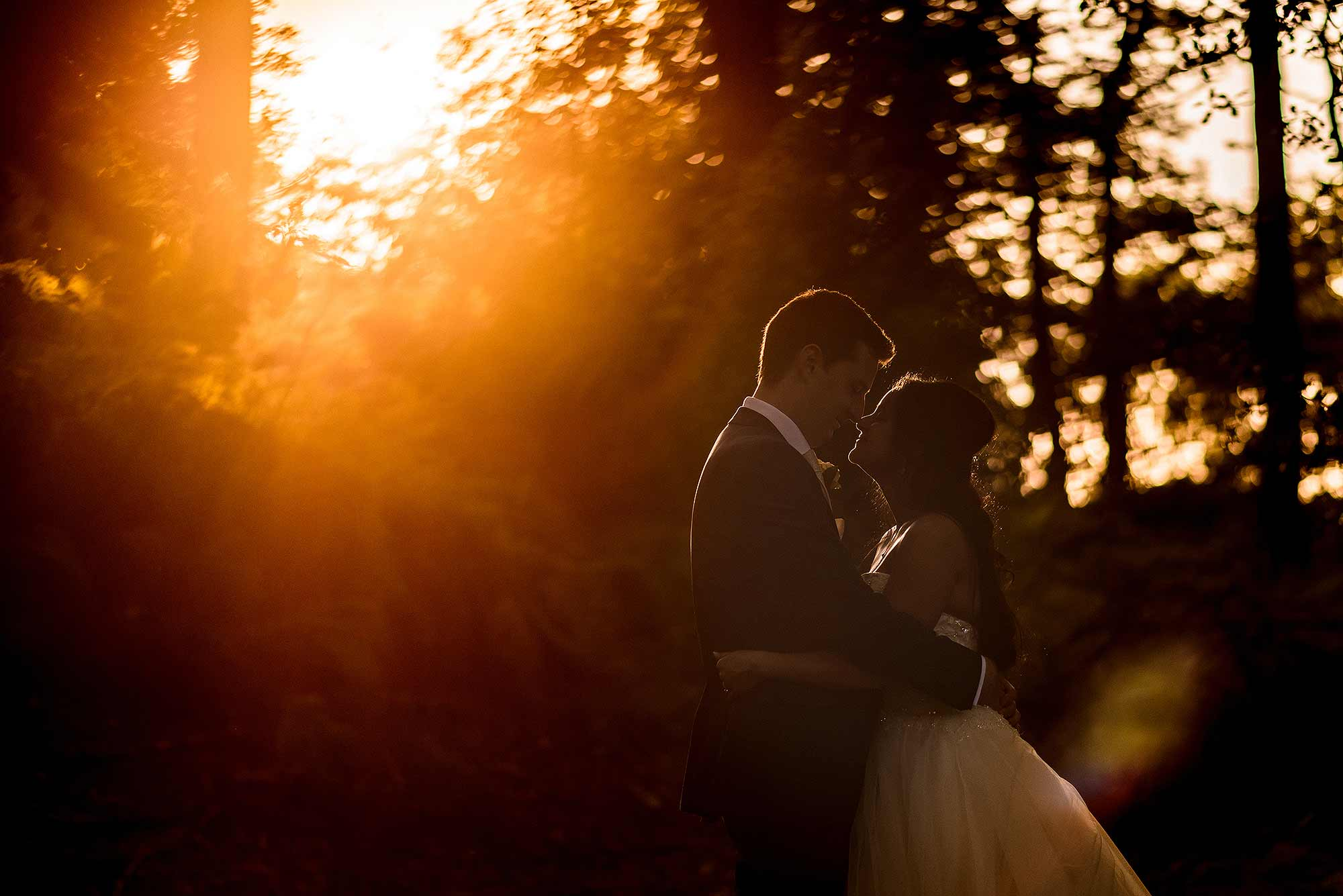 sunset photograph of bride and groom outside Peckforton Castle