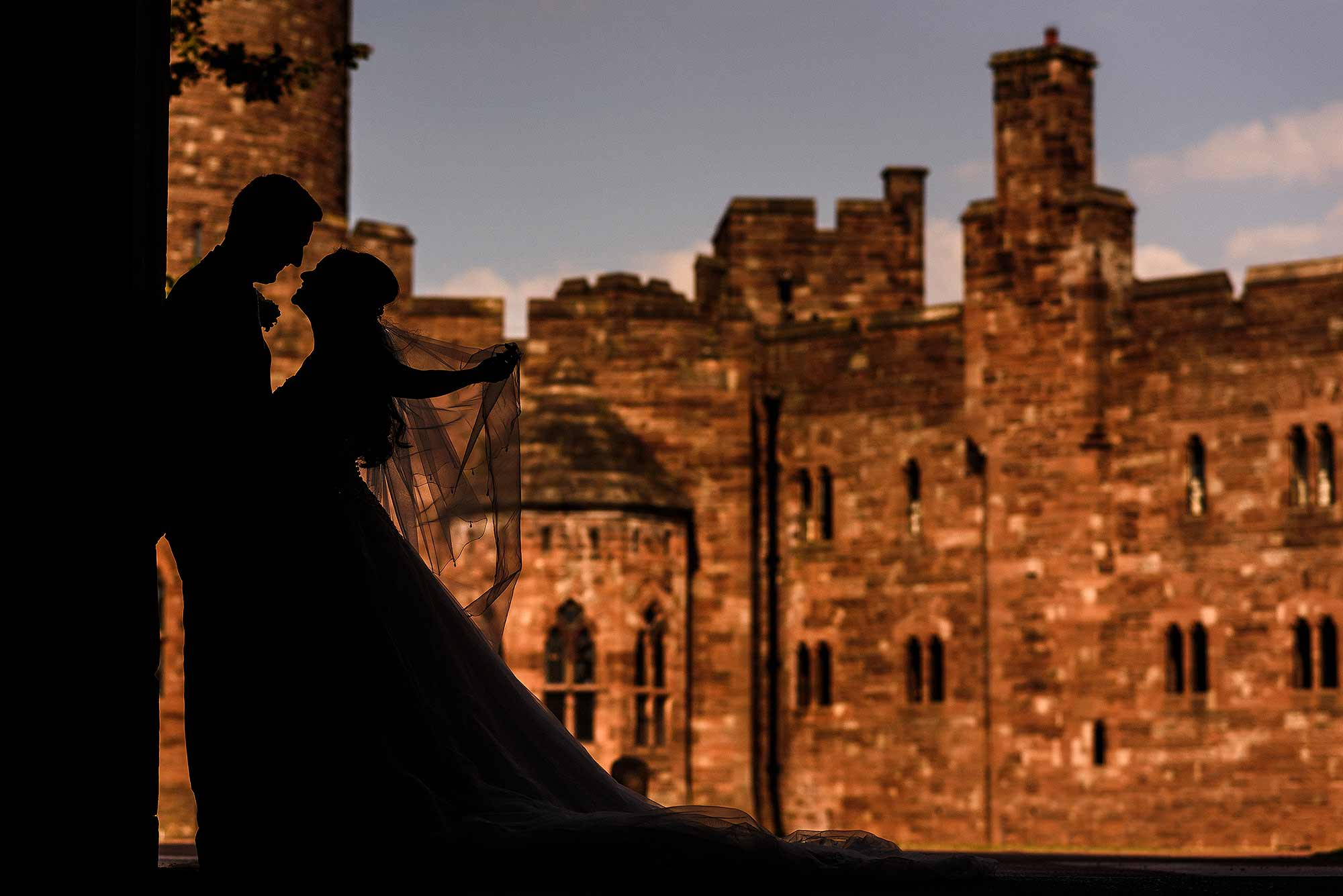 fairytale photograph of bride and groom at a Peckforton Castle wedding