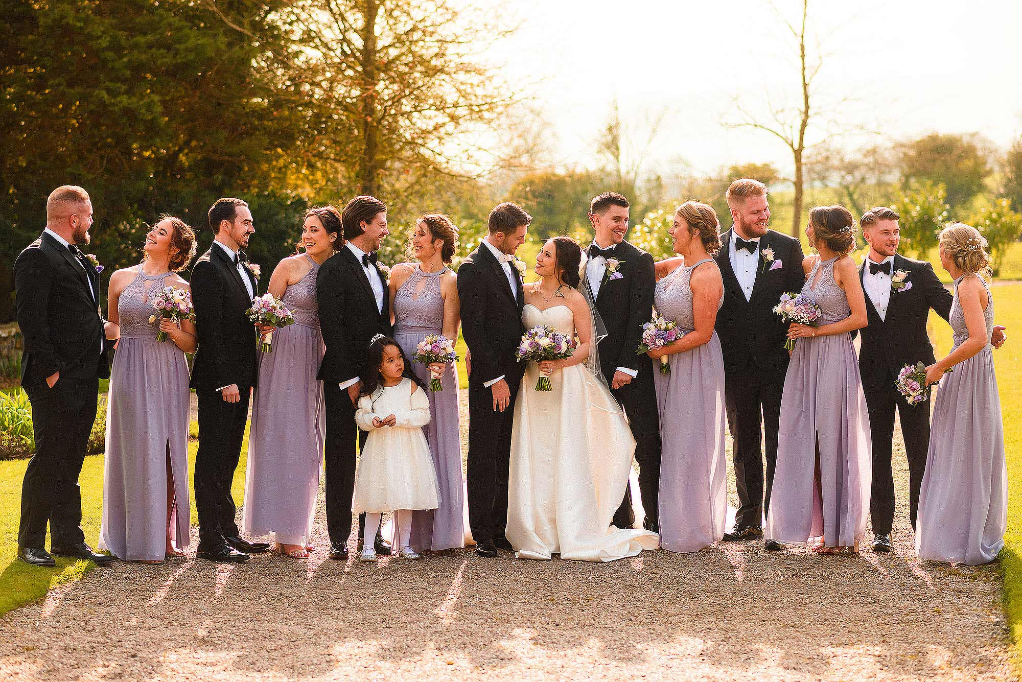 group photograph of bridal party in Eaves Hall gardens