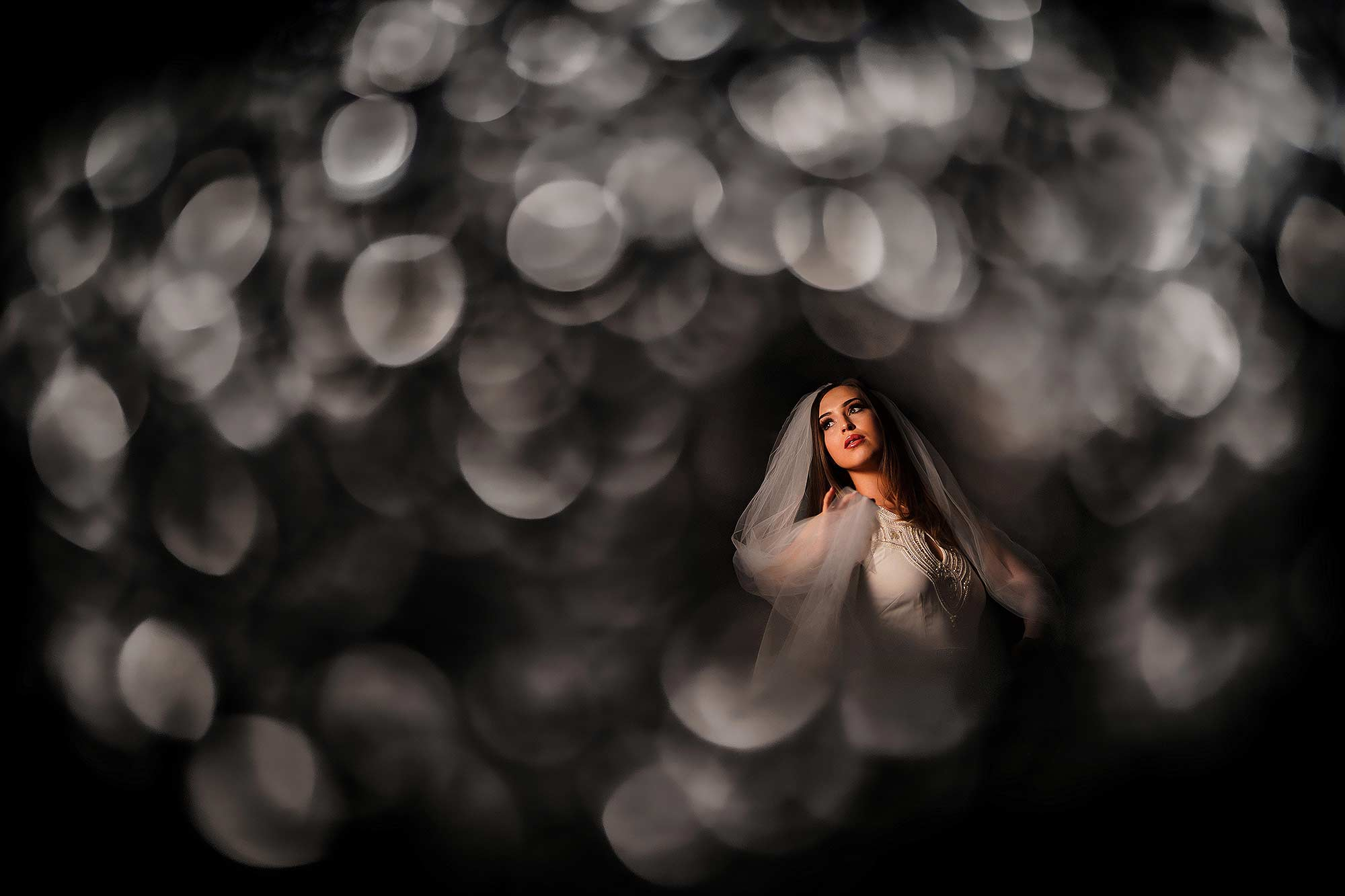 creative photograph of bride in Eaves Hall