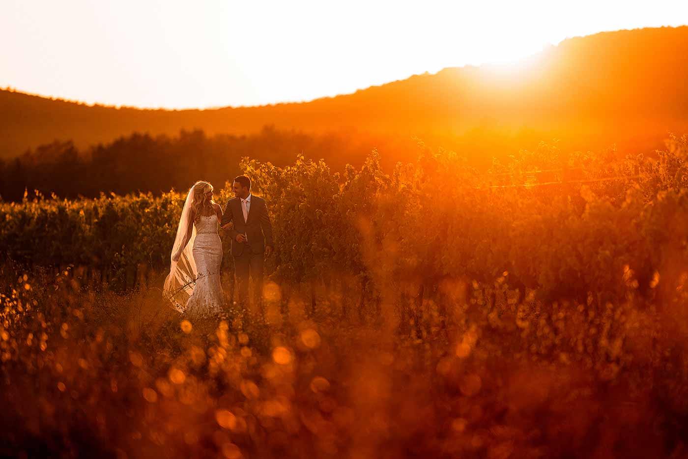 destination wedding bride and groom walking at sunset