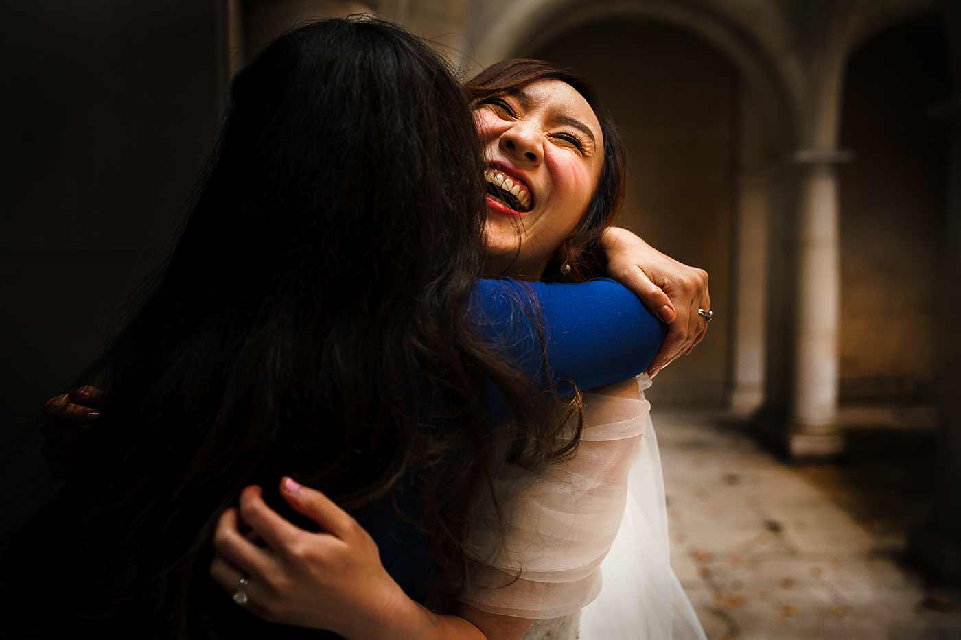 happy emotional moment between bride and best friend