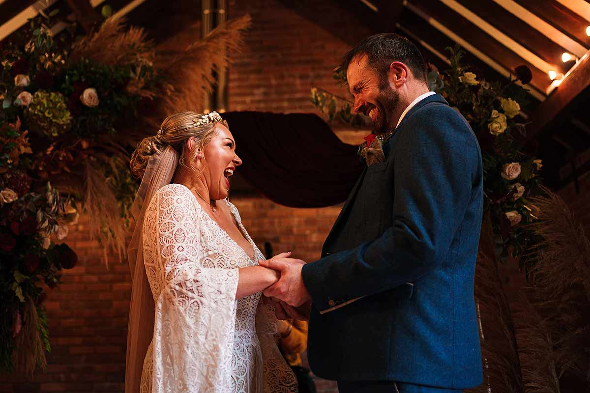 beautiful moment between bride and groom during exchange of vows